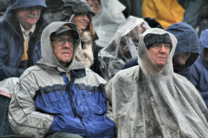 guys wearing a waterproof poncho and a rain coat