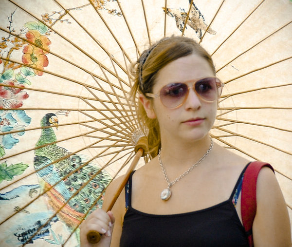 a women with a parsol umbrella